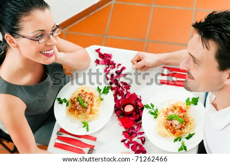 Couple at lunch or dinner; very romantic setting - stock photo