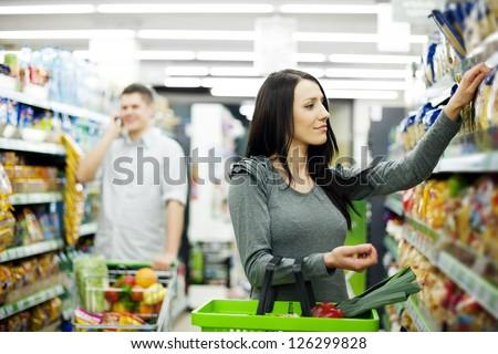 Couple at supermarket - stock photo