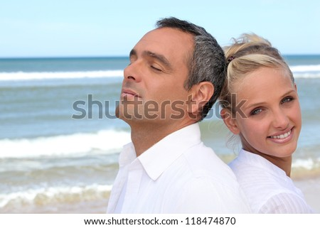 Couple at the seaside - stock photo