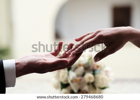 Couple at the wedding holding hands on holiday background, horizontal picture - stock photo