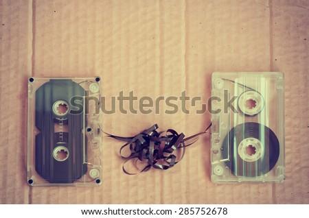 couple audio cassettes on cardboard, retro - stock photo