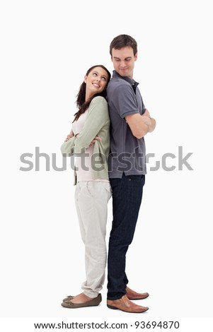 Couple back to back looking each other against white background - stock photo