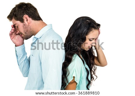 Couple back to back not talking after argument on white screen - stock photo