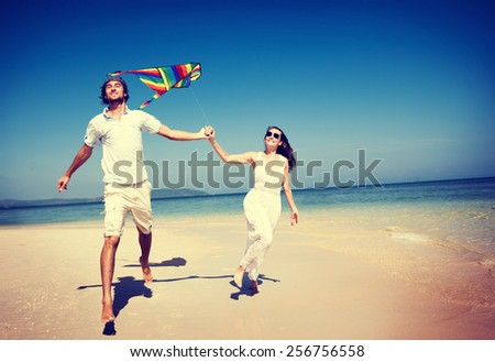 Couple Beach Kite Flying Getaway Holiday Concept - stock photo