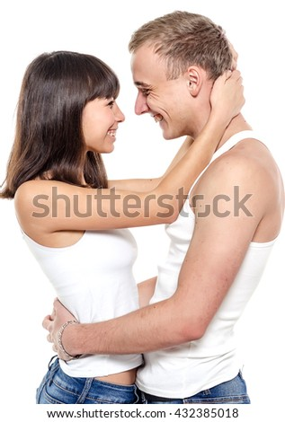 Couple. Beautiful couple over white background. Happy young family.