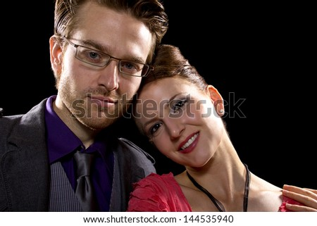 couple being close on a black background