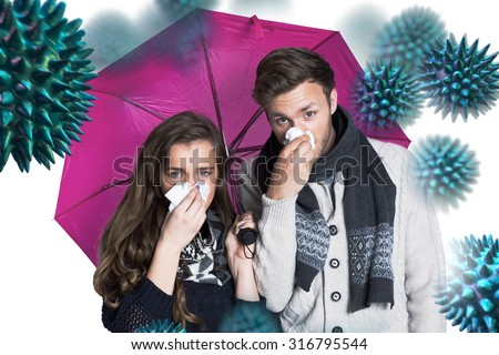 Couple blowing nose while holding umbrella against virus - stock photo