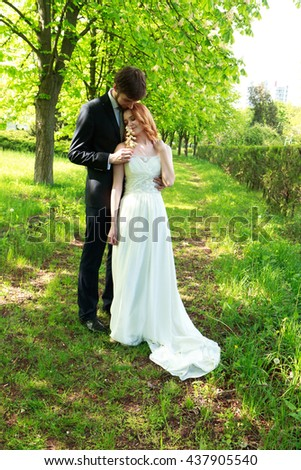 Couple bride and groom walking in the park of chestnuts - stock photo