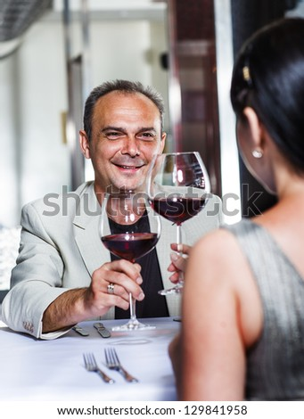 Couple celebrating in a restaurant - stock photo