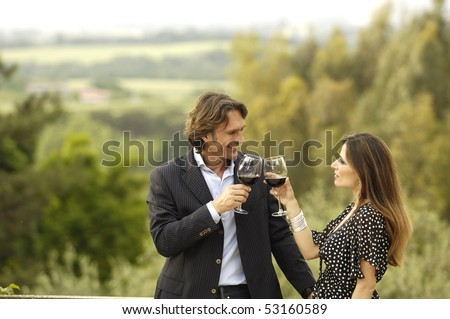 Couple celebrating in the country - stock photo