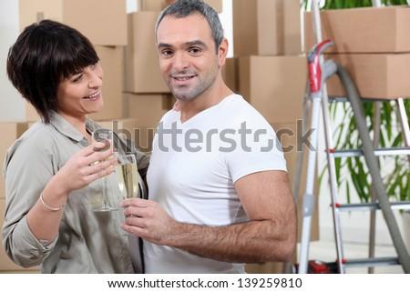 couple celebrating removal - stock photo