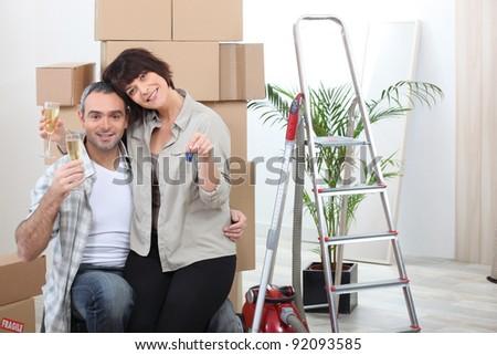 couple celebrating their new apartment - stock photo
