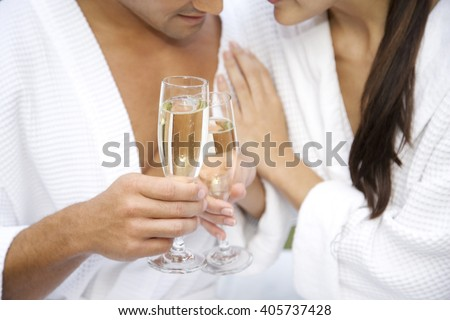 Couple celebrating with champagne - stock photo