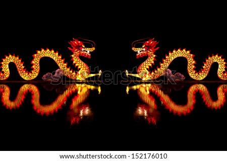 Couple Chinese Dragon Lantern on pond - stock photo