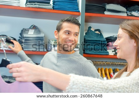 Couple clothes shopping together - stock photo