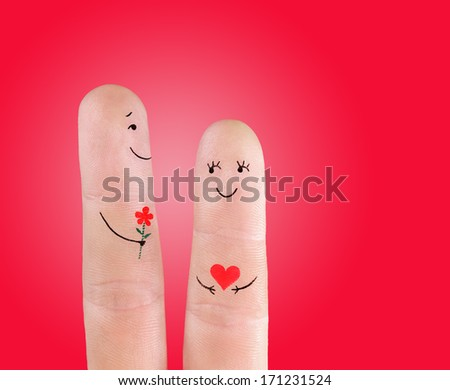 couple concept - man with flower and woman, painted at fingers on red background