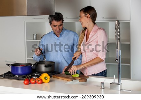 couple cooking in the  kitchen - stock photo