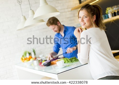 Couple cooking together in the kitchen at home - stock photo