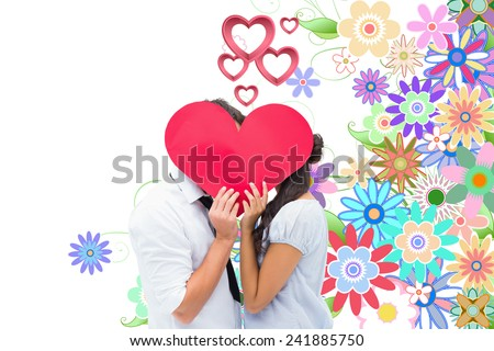 Couple covering their kiss with a heart against digitally generated girly floral design - stock photo