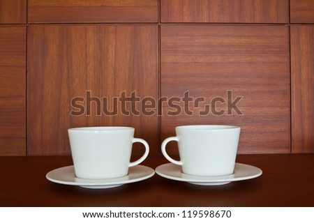 Couple cup of coffee on wooden background - stock photo