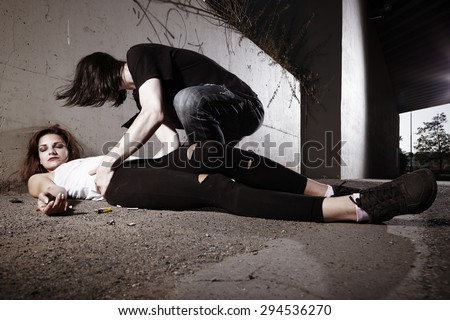 Couple deep in drugs using pervitin directly on street up to death of one - stock photo