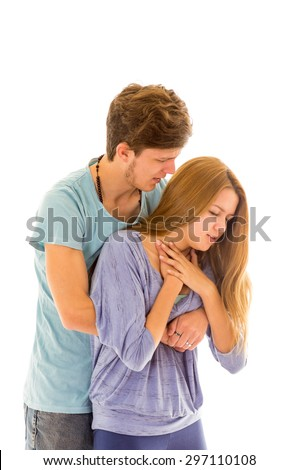 Couple demonstrating first aid procedure for abdominal thrusts, Heimlich Manoeuvre or Maneuver to treat woman choking by foreign objects - stock photo