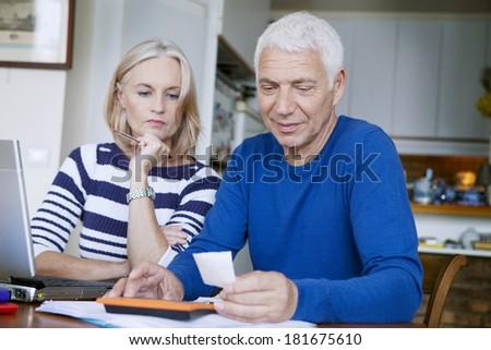 Couple Doing Paperwork - stock photo