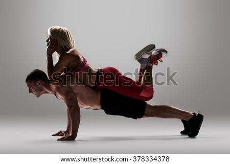 couple doing push ups - stock photo
