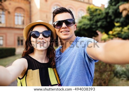 Couple doing selfie outdoors.