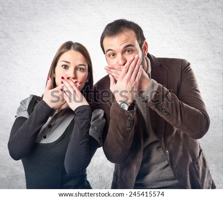 Couple doing surprise gesture over textured background  - stock photo