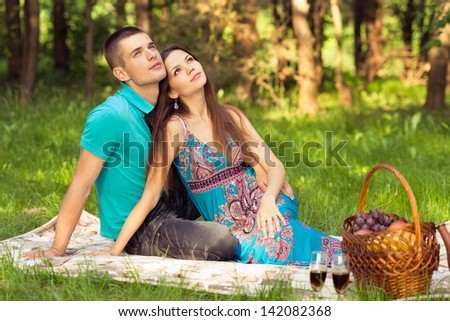 couple dreaming of future. outdoors portrait at picnic - stock photo