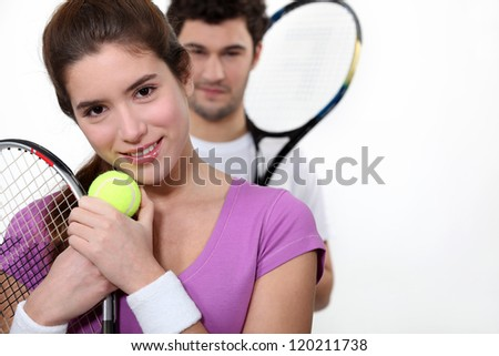 Couple dressed for tennis - stock photo