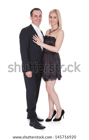 Couple Dressed In Formal Attire Stand Over White Background - stock photo