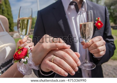 Couple drinking champagne during wedding reception outdoors