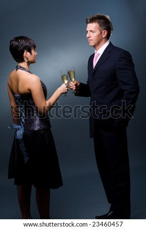 Couple drinking champagne on a party. - stock photo
