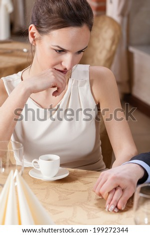 Couple drinking espresso in a restaurant, vertical