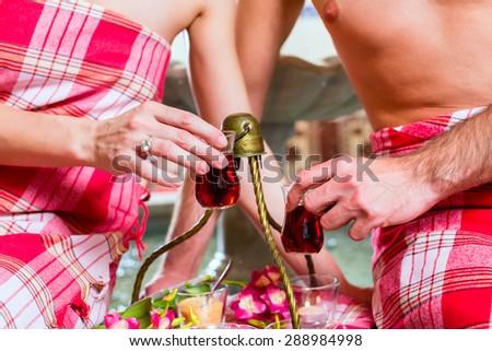Couple drinking Turkish tea in wellness spa - stock photo