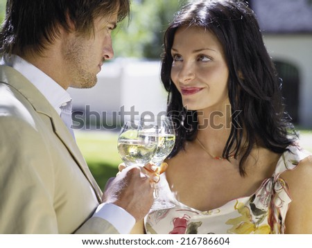 Couple drinking white wine. - stock photo