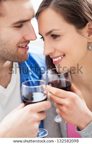 Couple drinking wine - stock photo