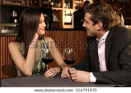 Couple drinking wine - stock photo