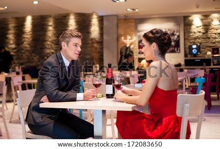 Couple drinking wine and enjoying at the restaurant - stock photo