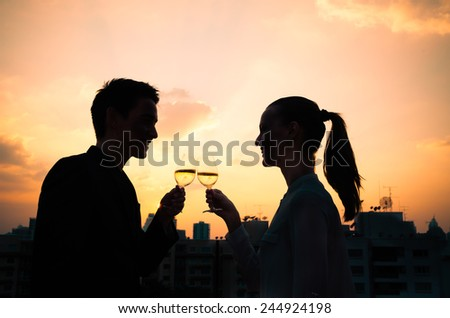Couple drinking wine. First date - stock photo