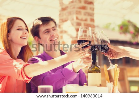 Couple drinking wine in the cafe - stock photo