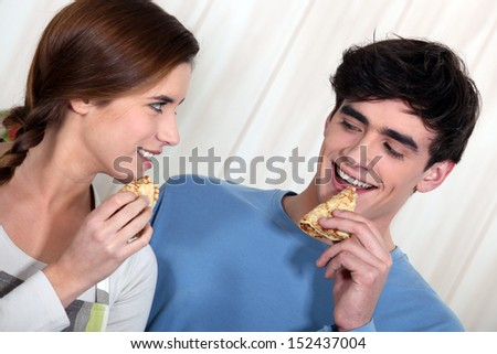 Couple eating pancakes
