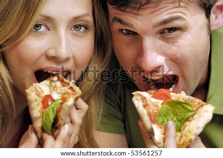 couple eating pizza - stock photo