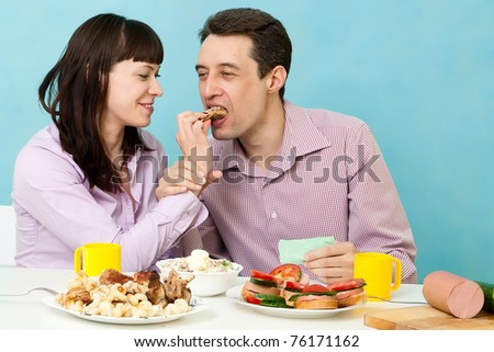 Couple eating together on kitchen