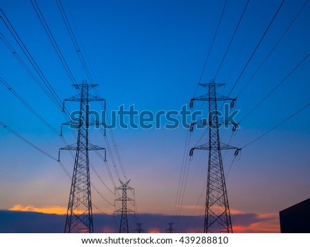 Couple Electricity pylon at sunset