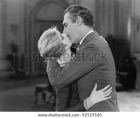 Couple embraced and kissing each other - stock photo