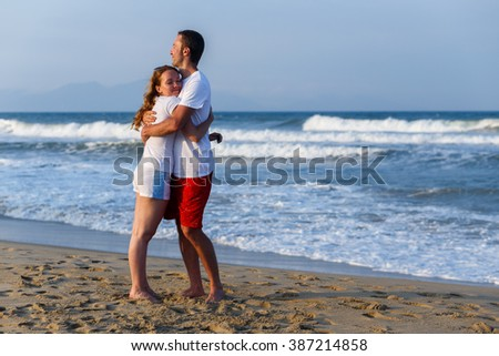 Couple embracing each other by the sea - stock photo
