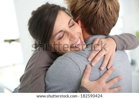 Couple embracing, happy to get back together - stock photo